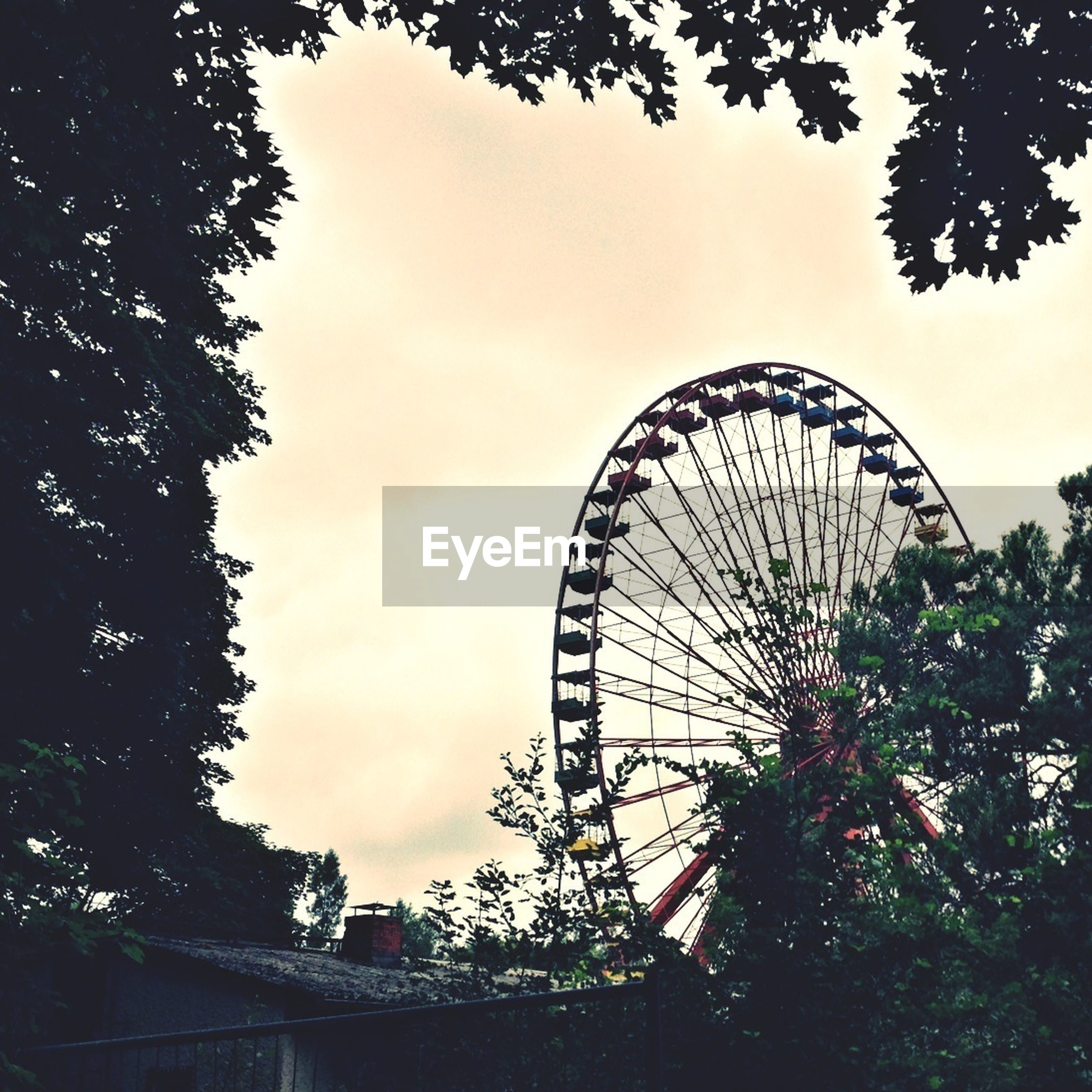 Low angle view of giant wheel against sky