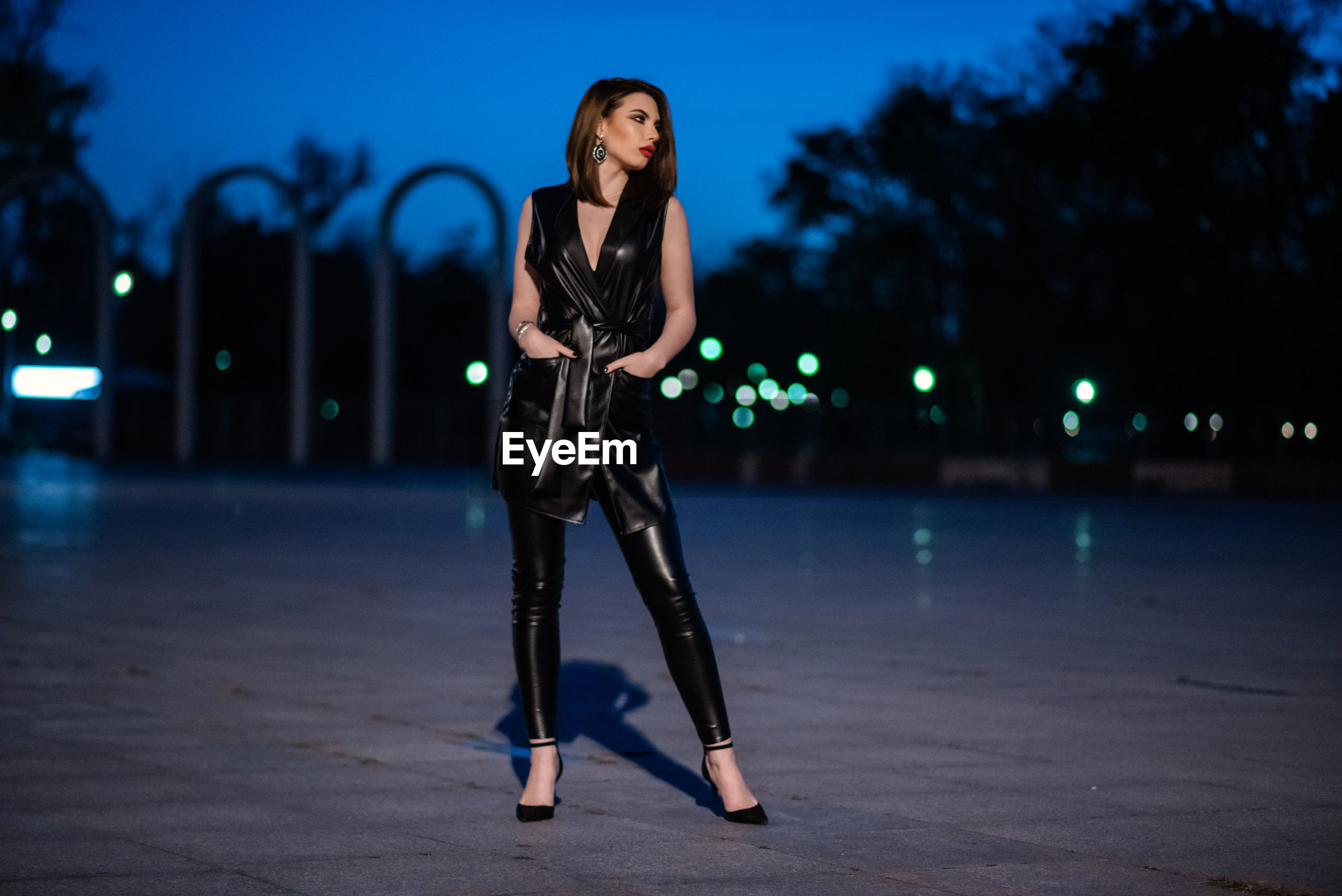 Full length portrait of woman standing at night