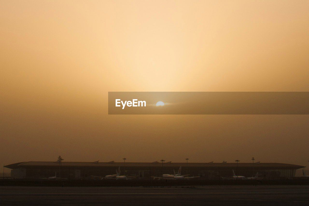sun, sunset, transportation, sky, mode of transport, no people, outdoors, scenics, land vehicle, nature, airplane, beauty in nature, air vehicle, landscape, clear sky, day