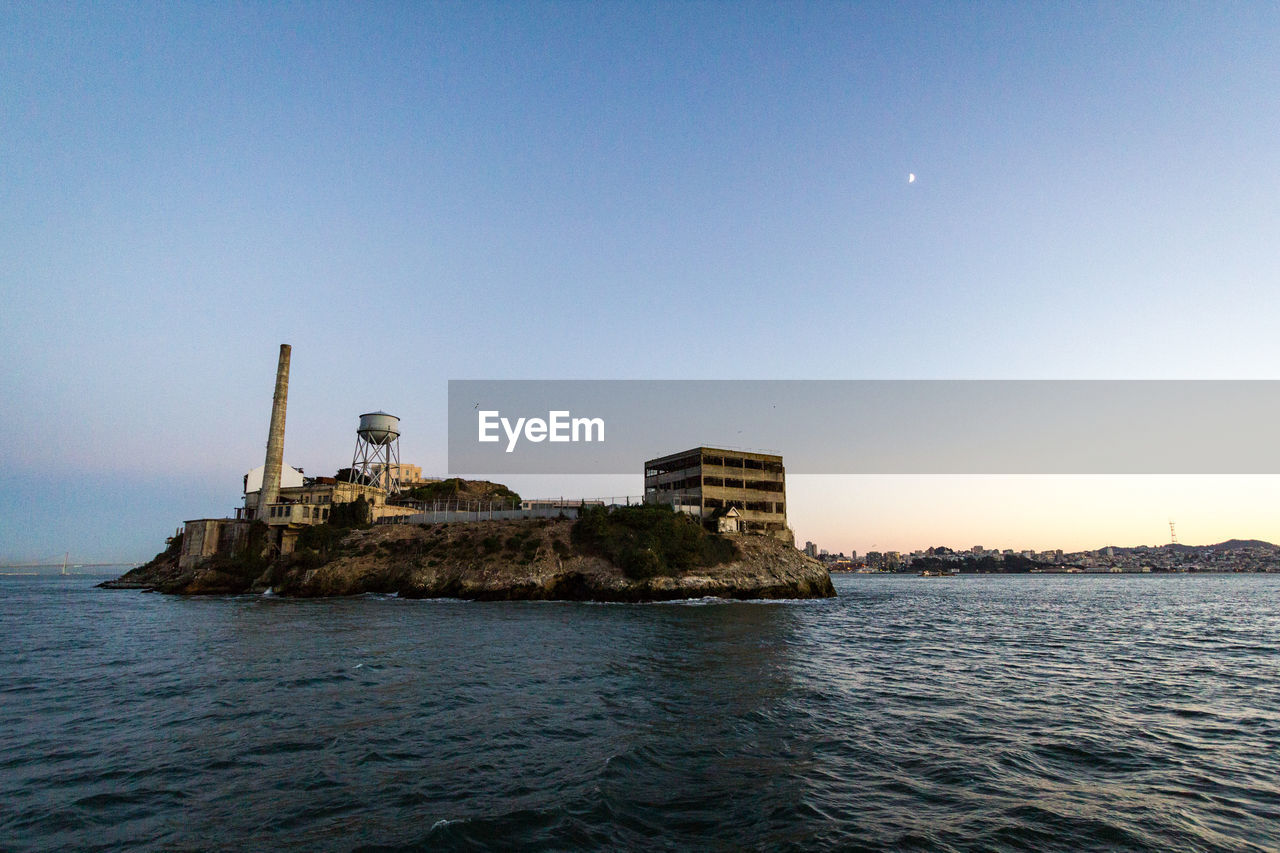water, sky, sea, waterfront, architecture, built structure, clear sky, nature, no people, building exterior, copy space, scenics - nature, beauty in nature, tranquility, tranquil scene, outdoors, day, building, blue