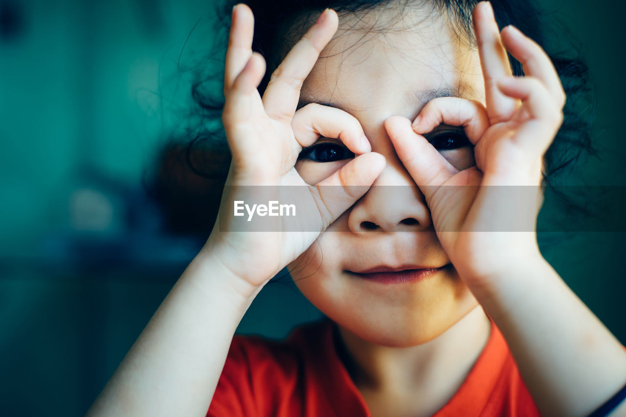 Portrait Of Girl Covering Eyes