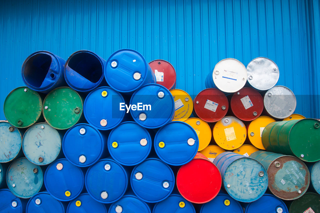 Stacked Plastic Barrels At Factory
