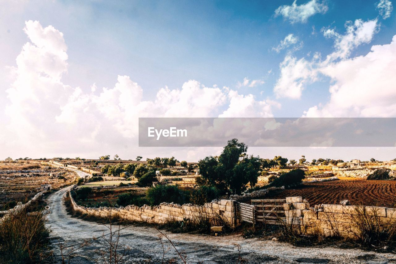 sky, day, no people, landscape, scenics, outdoors, cloud - sky, nature, tranquility, built structure, beauty in nature, architecture, rural scene