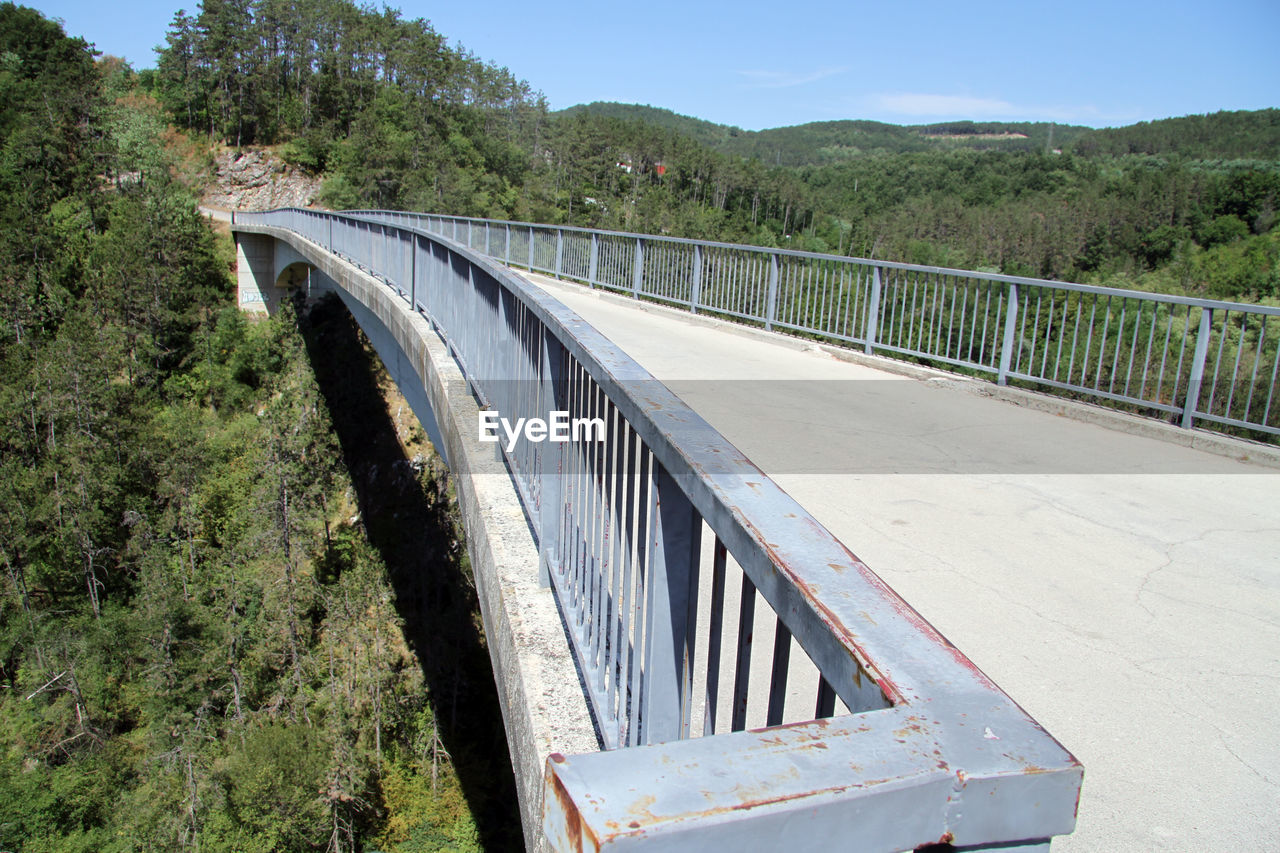 transportation, bridge, tree, connection, plant, bridge - man made structure, architecture, built structure, day, nature, no people, road, sky, railing, mountain, river, water, environment, outdoors, arch bridge