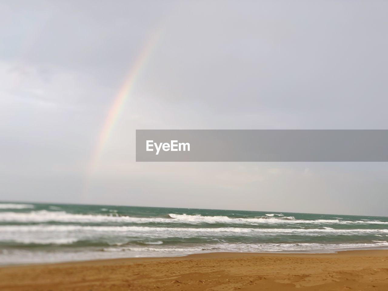 sky, sea, horizon, water, rainbow, horizon over water, beauty in nature, scenics - nature, land, beach, cloud - sky, wave, nature, tranquility, sand, motion, tranquil scene, no people, outdoors, flowing water