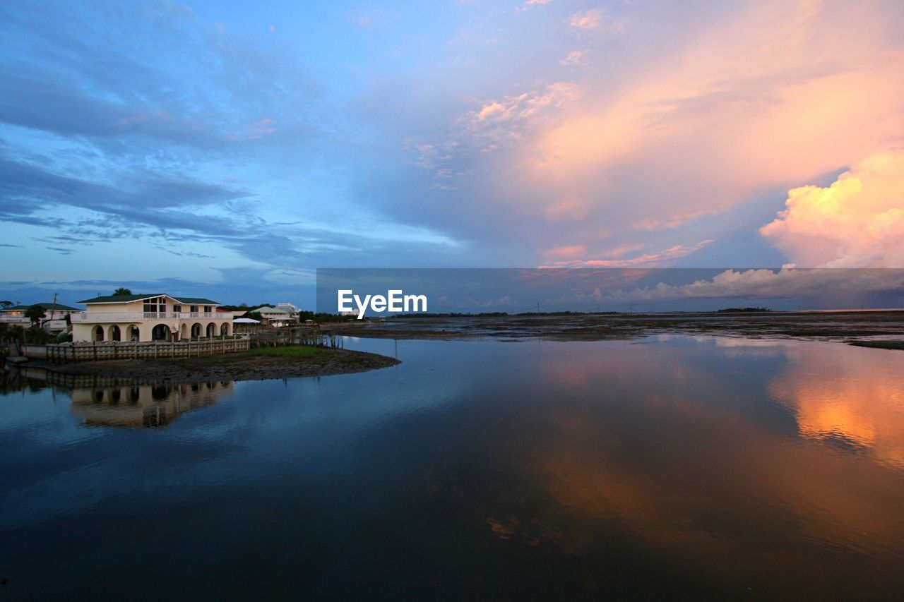 sky, architecture, cloud - sky, reflection, water, built structure, sunset, building exterior, scenics, outdoors, beauty in nature, nature, tranquil scene, no people, tranquility, lake, day