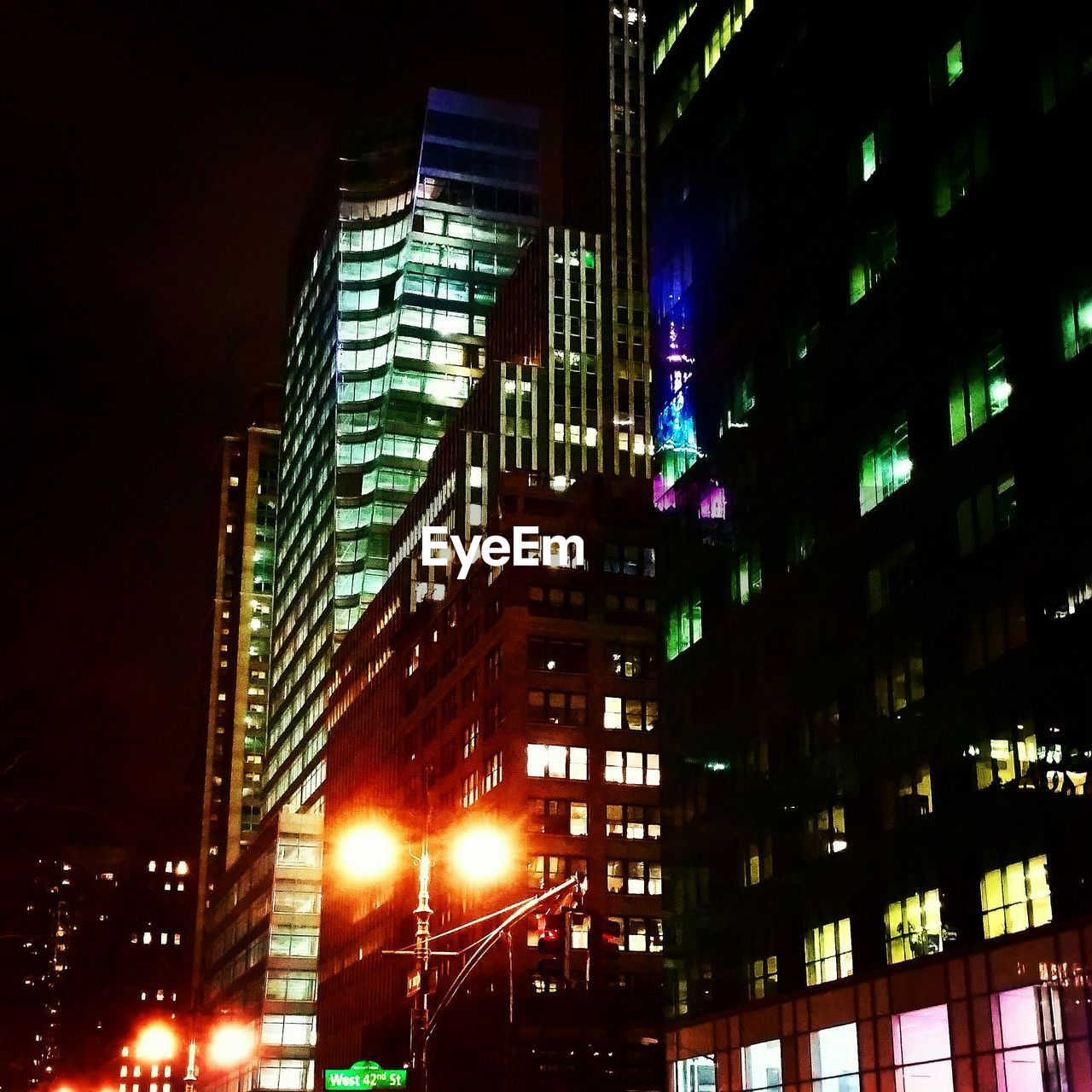 illuminated, night, architecture, building exterior, low angle view, city, skyscraper, built structure, modern, no people, outdoors, sky