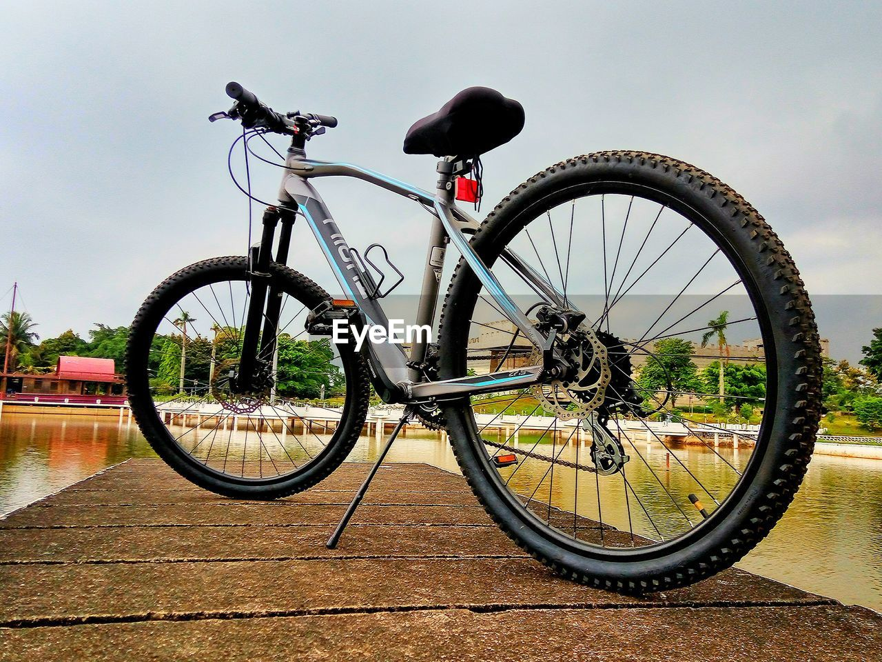 bicycle, transportation, land vehicle, mode of transport, day, stationary, parking, outdoors, no people, bicycle rack, wheel, sky, tire, nature, close-up