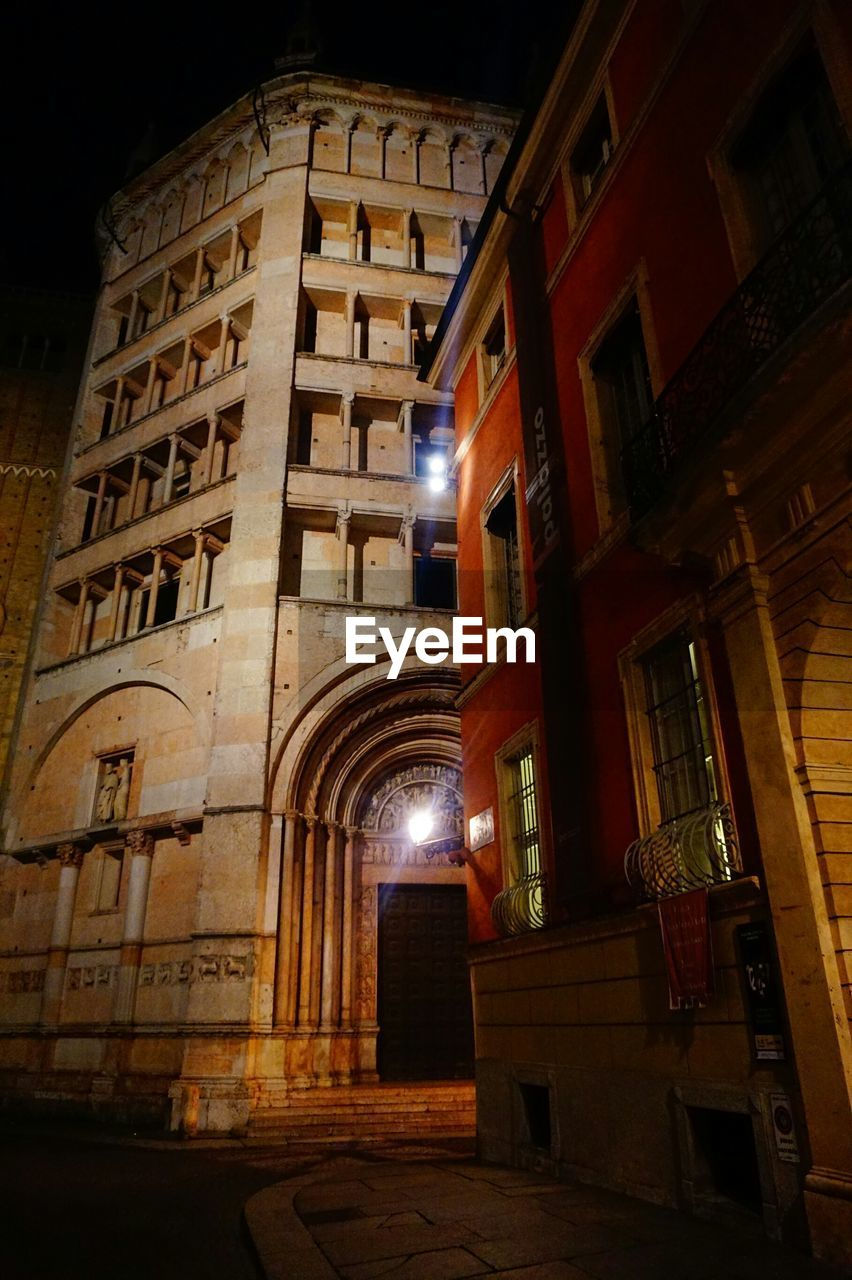 Low angle view of parma cathedral in city at night