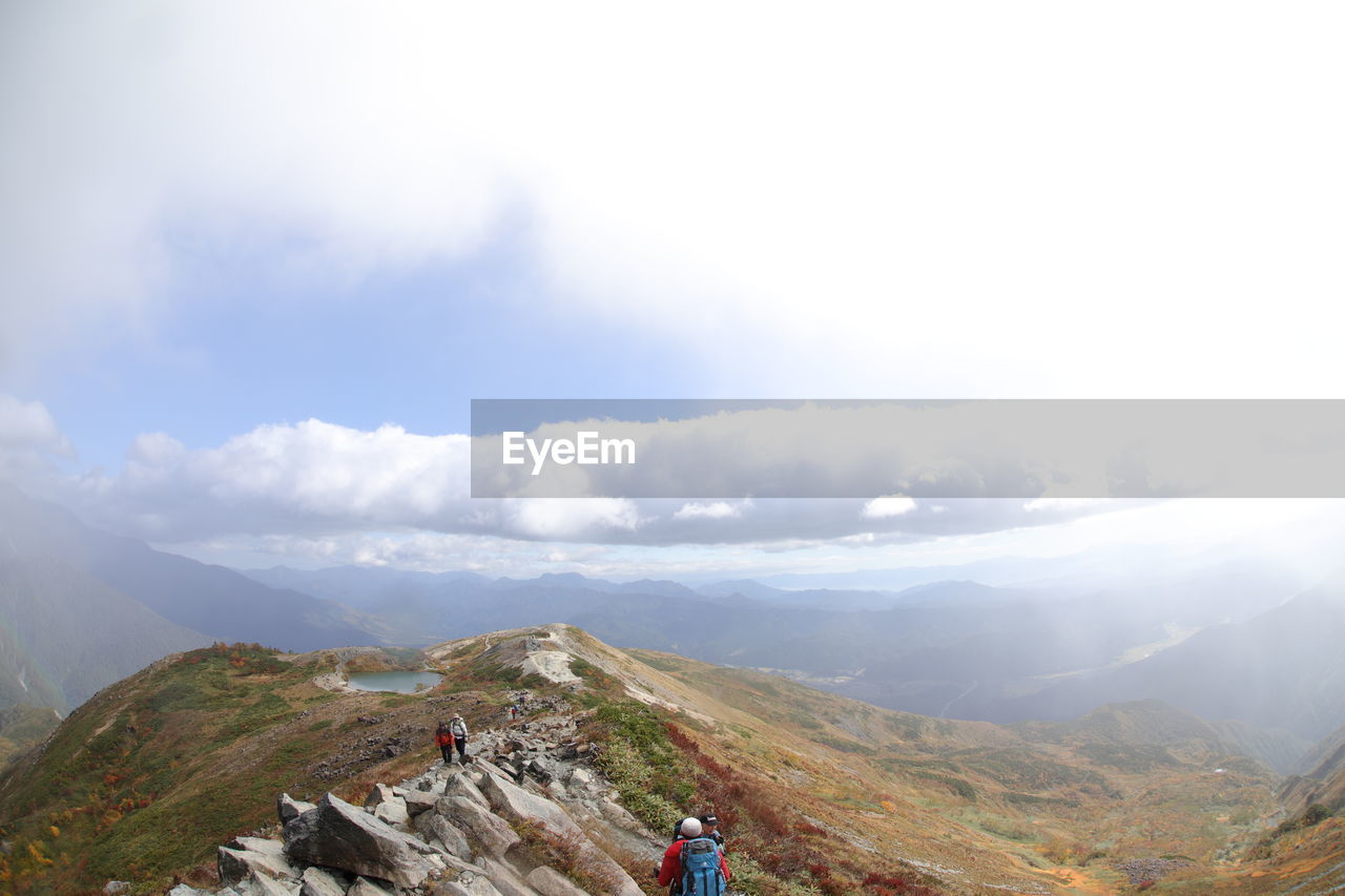 mountain, sky, cloud - sky, scenics - nature, beauty in nature, tranquil scene, environment, mountain range, non-urban scene, tranquility, landscape, nature, day, adventure, remote, leisure activity, hiking, idyllic, travel, activity, outdoors