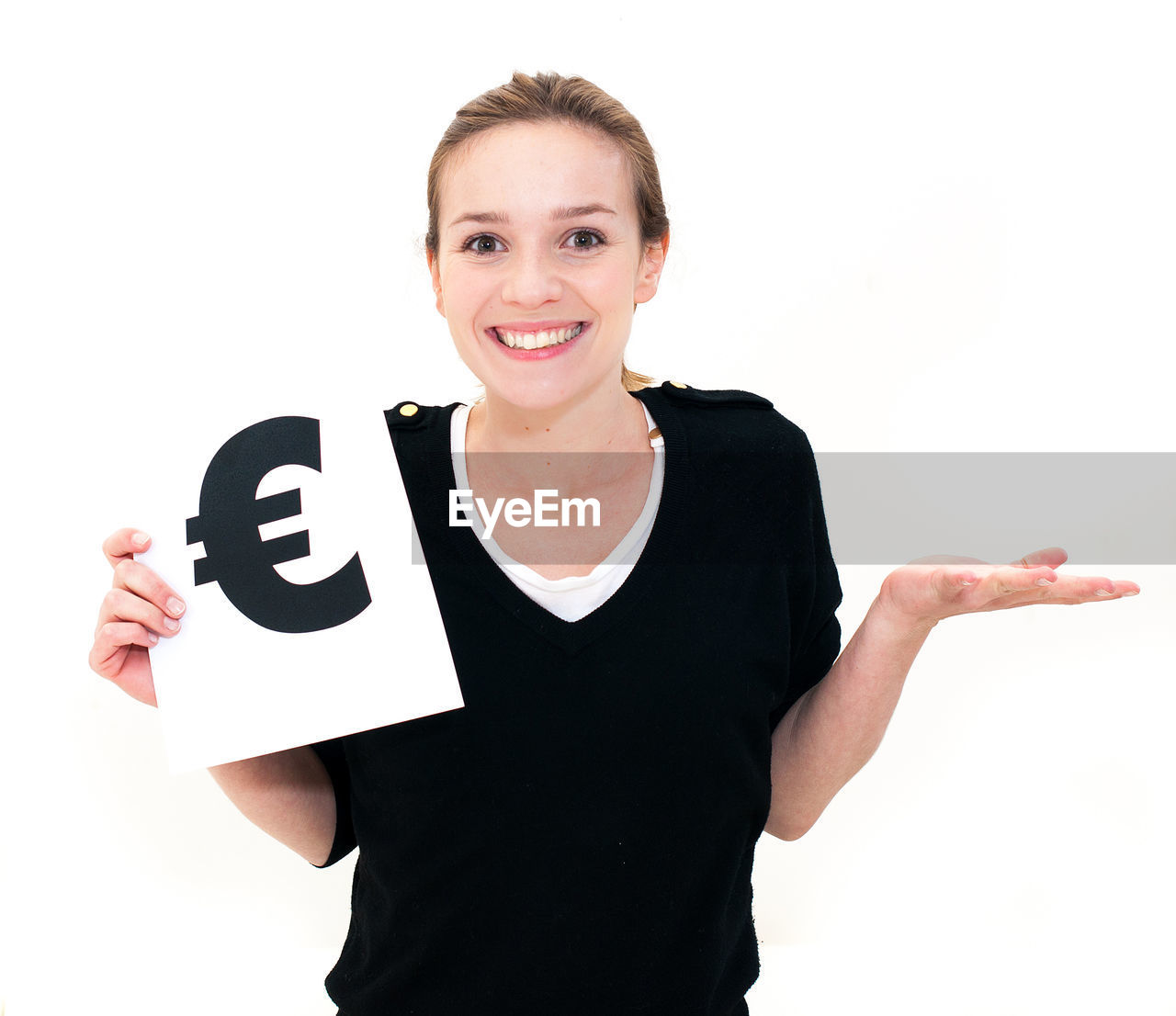 Portrait of smiling woman with euro symbol on placard against white background