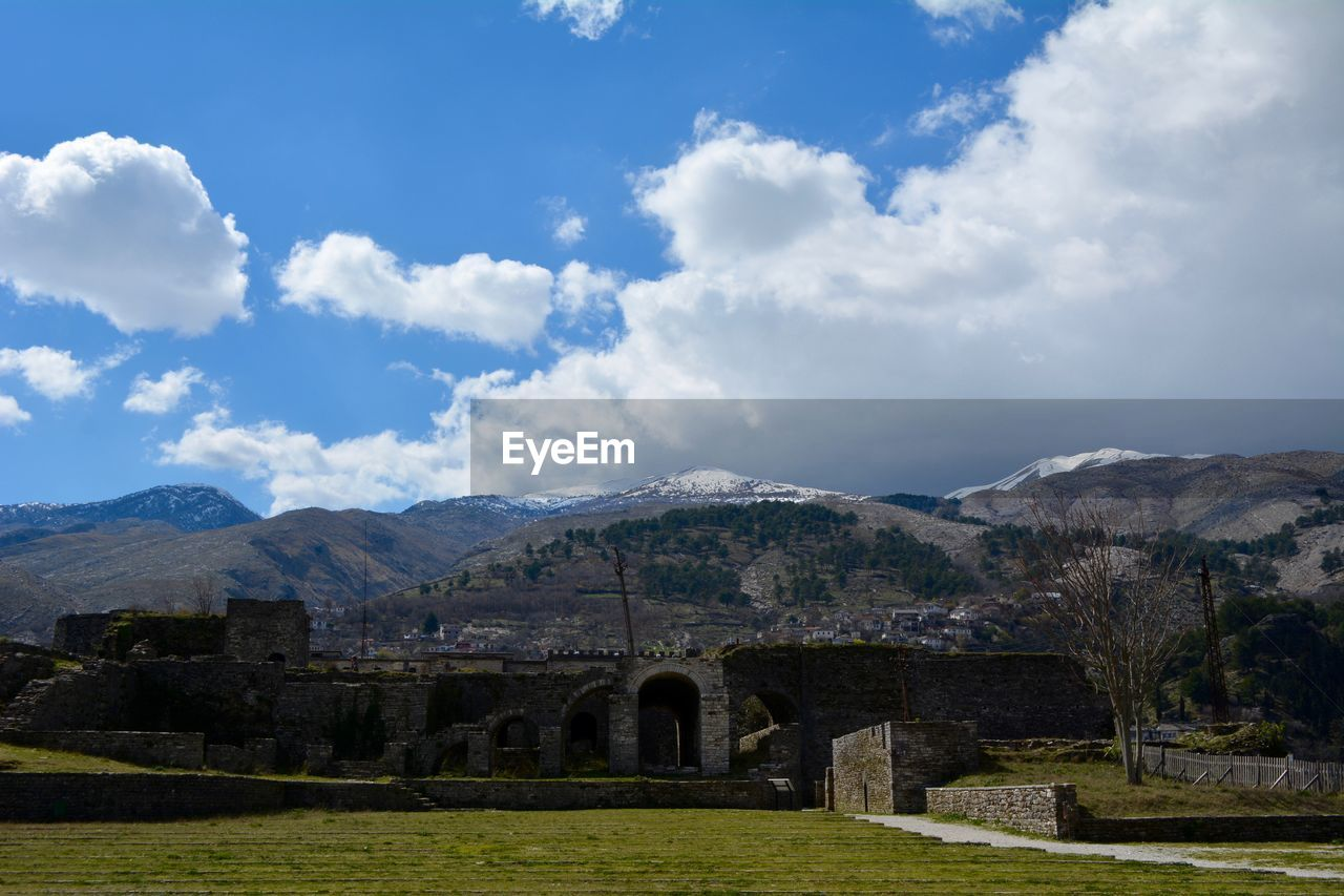 sky, cloud - sky, mountain, nature, built structure, architecture, day, history, no people, landscape, beauty in nature, the past, plant, scenics - nature, environment, grass, tranquil scene, tranquility, ancient, land, ancient civilization, outdoors, archaeology