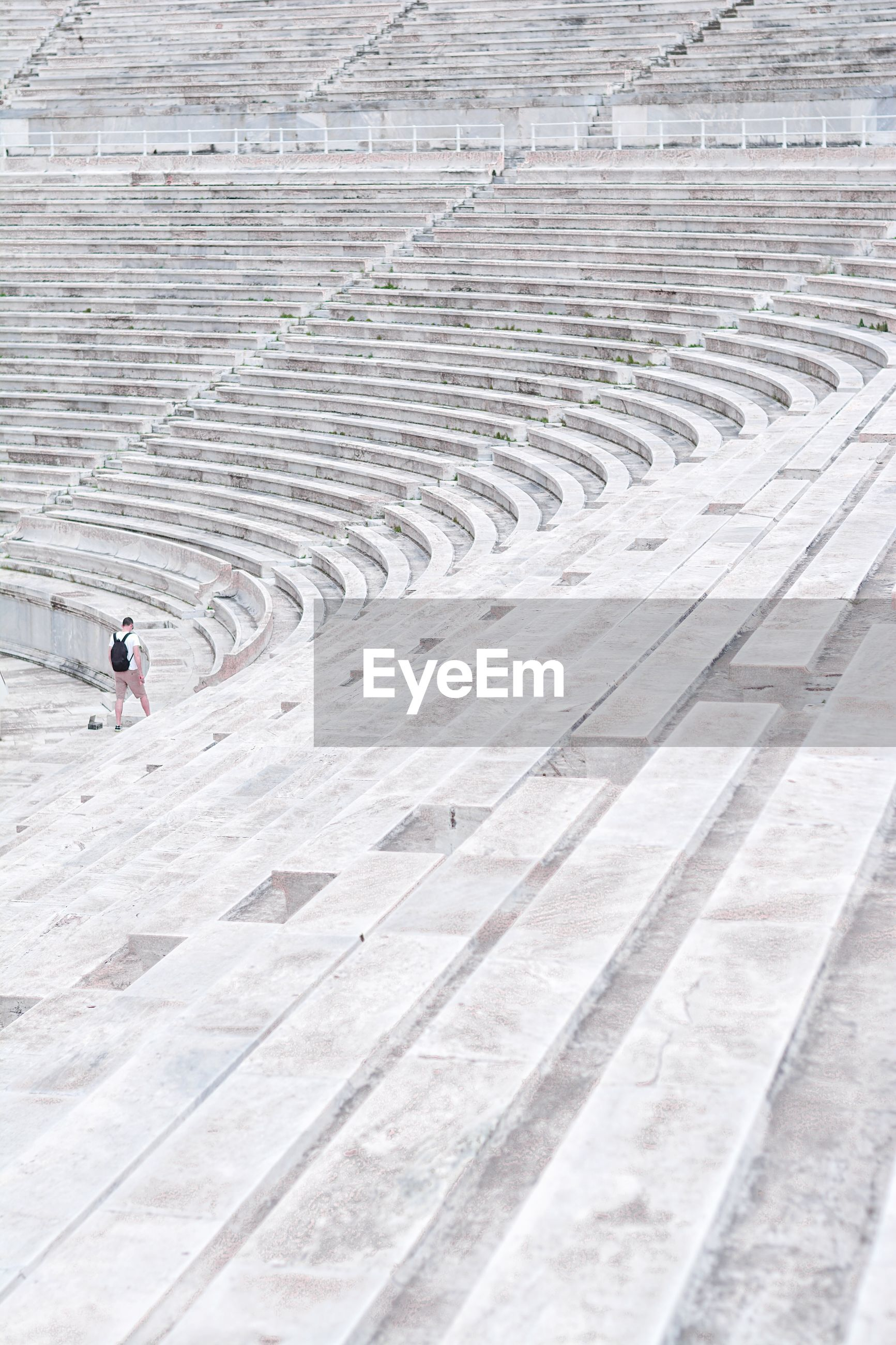 High angle view of man walking on steps at amphitheater