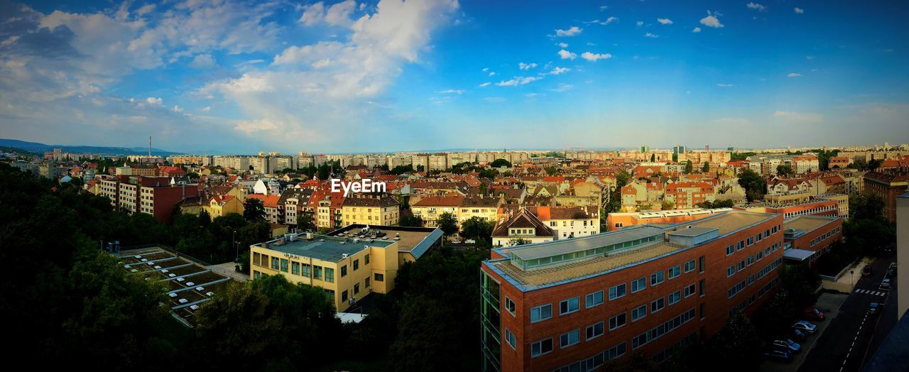 architecture, sky, building exterior, built structure, no people, city, cloud - sky, panoramic, roof, outdoors, cityscape, day, tree, nature