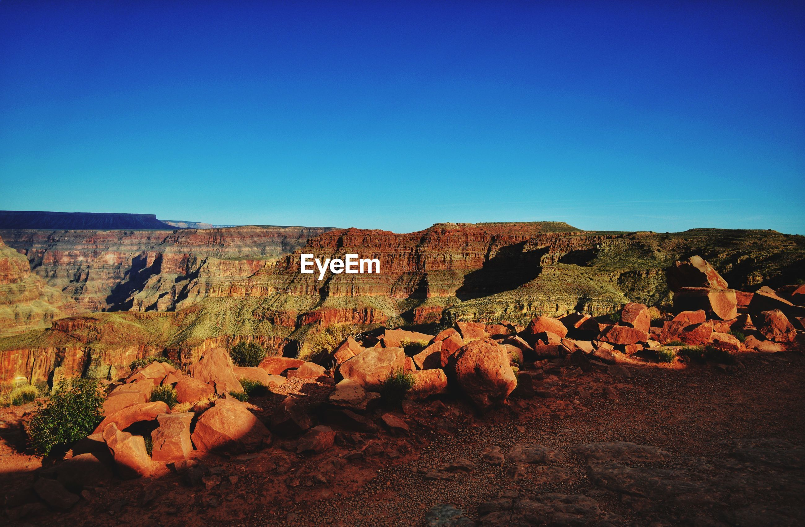 SCENIC VIEW OF ROCKS AGAINST CLEAR SKY