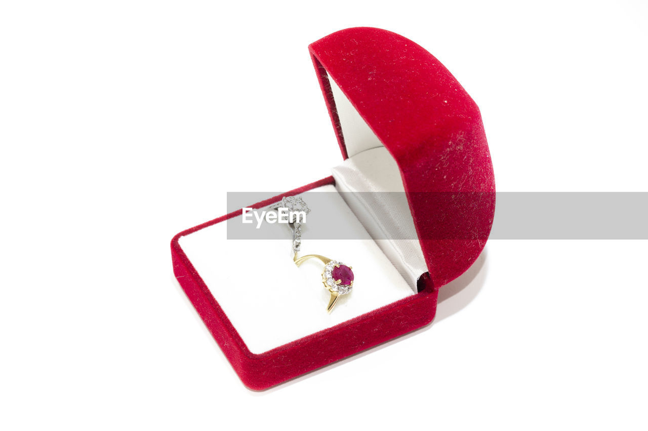 white background, red, studio shot, cut out, still life, indoors, heart shape, copy space, love, positive emotion, no people, emotion, two objects, close-up, box, box - container, container, high angle view, jewelry, valentine's day - holiday
