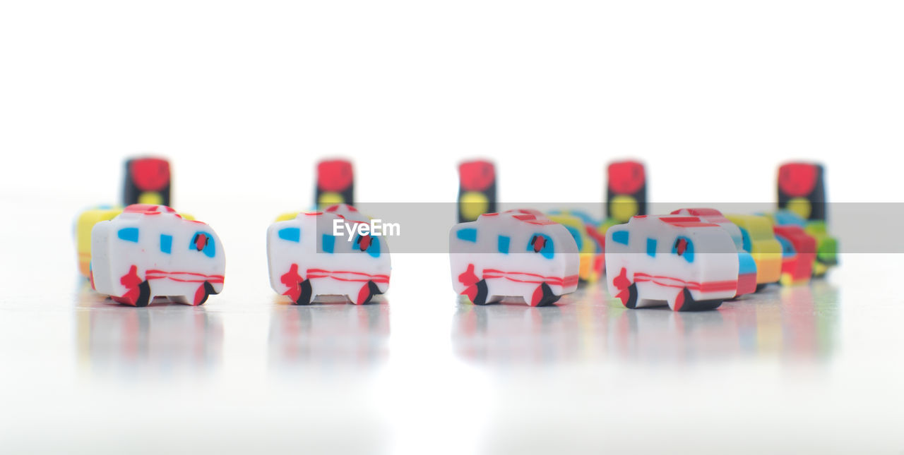 Close-Up Of Erasers Over White Background