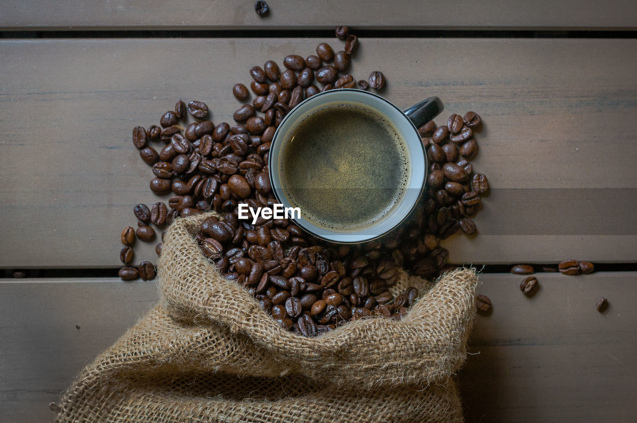 Close-Up View Of Coffee And Coffee Beans