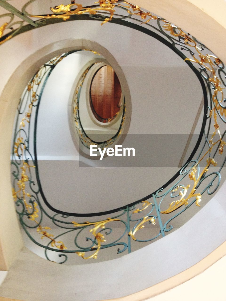 staircase, steps and staircases, spiral, railing, built structure, indoors, steps, architecture, no people, stairs, spiral stairs, low angle view, hand rail, spiral staircase, close-up, day