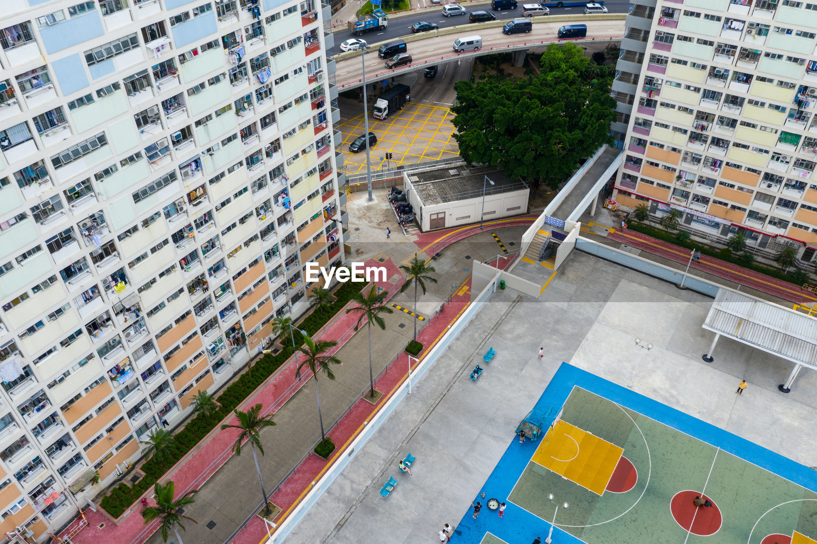 High angle view of buildings by playground in city