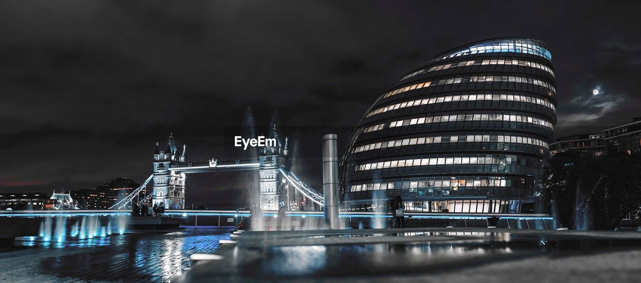 night, architecture, illuminated, built structure, building exterior, sky, travel destinations, modern, water, cloud - sky, outdoors, waterfront, no people, river, long exposure, city, skyscraper, futuristic, cityscape, nature