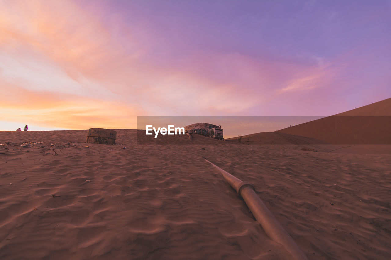 Water Storage Tanks With Pipe Line On Sand In Desert