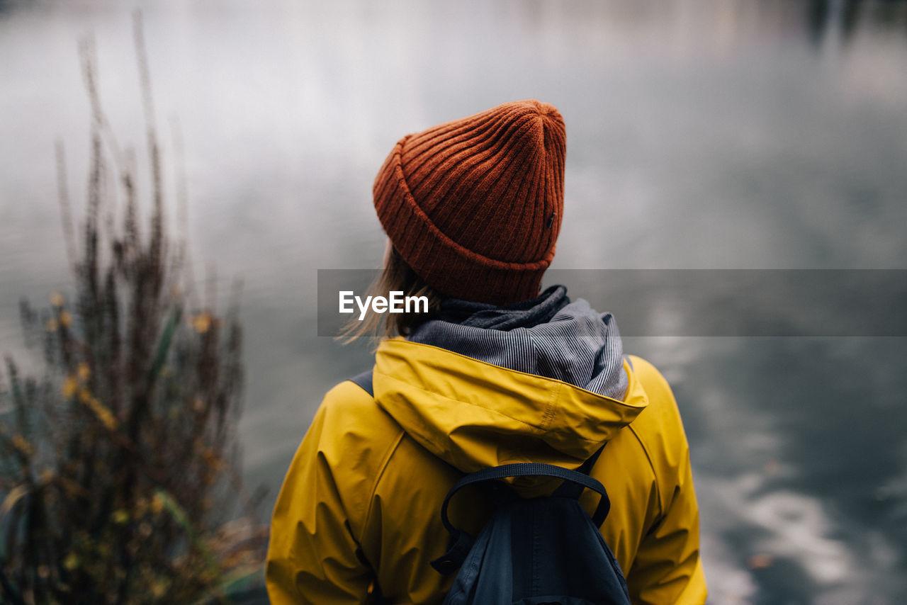 Rear View Of Woman Looking At Lake