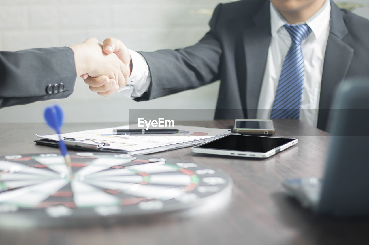 businessman, business, table, business person, men, office, occupation, adult, males, working, cooperation, indoors, corporate business, professional occupation, businesswear, well-dressed, suit, midsection, selective focus, formalwear, teamwork, coworker, formal businesswear, hand