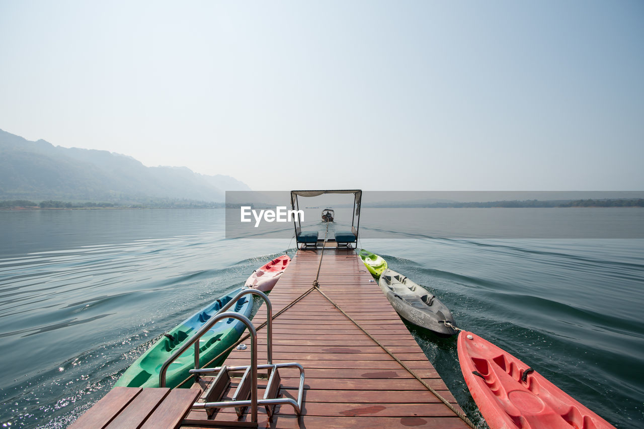 water, sky, nautical vessel, clear sky, nature, transportation, beauty in nature, scenics - nature, day, tranquility, tranquil scene, mode of transportation, lake, copy space, no people, non-urban scene, outdoors, idyllic