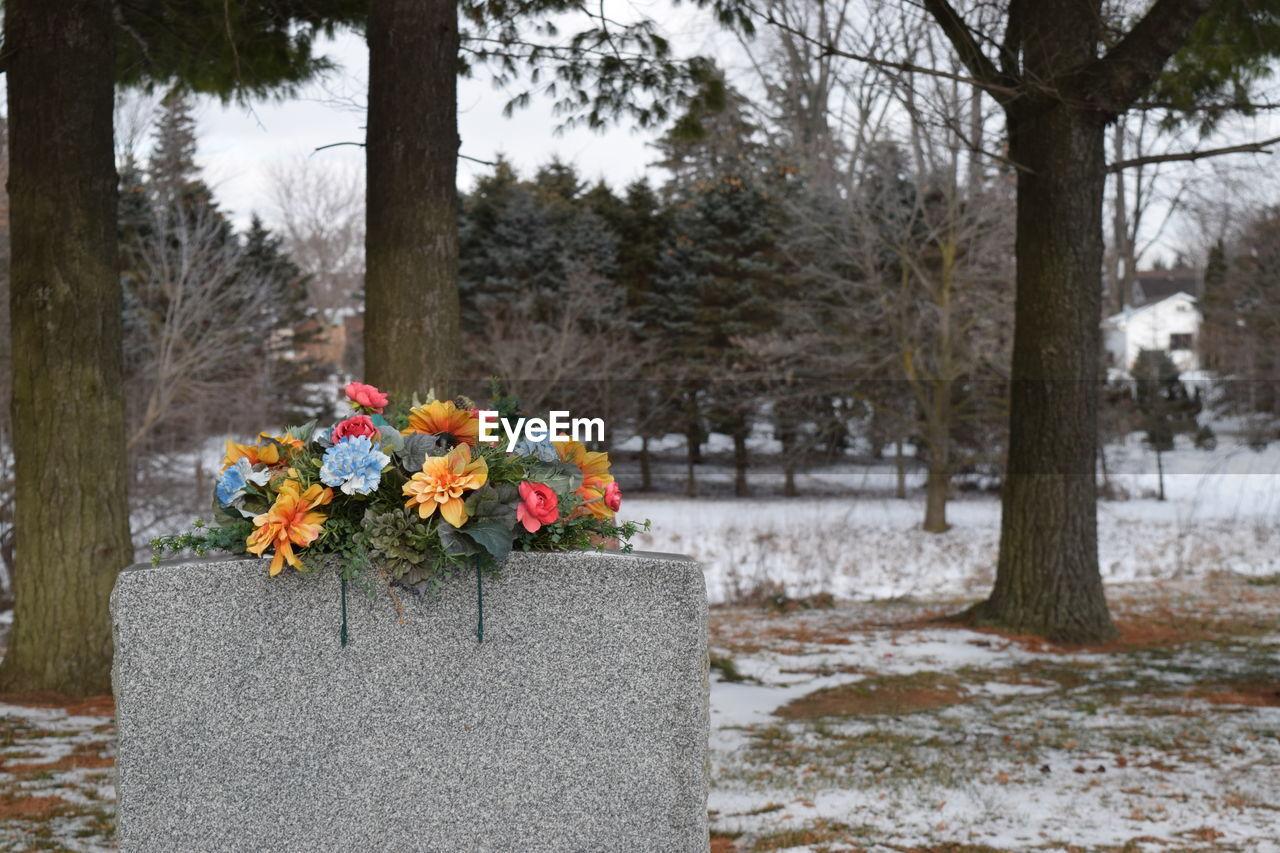 Flower Bouquet On Tombstone