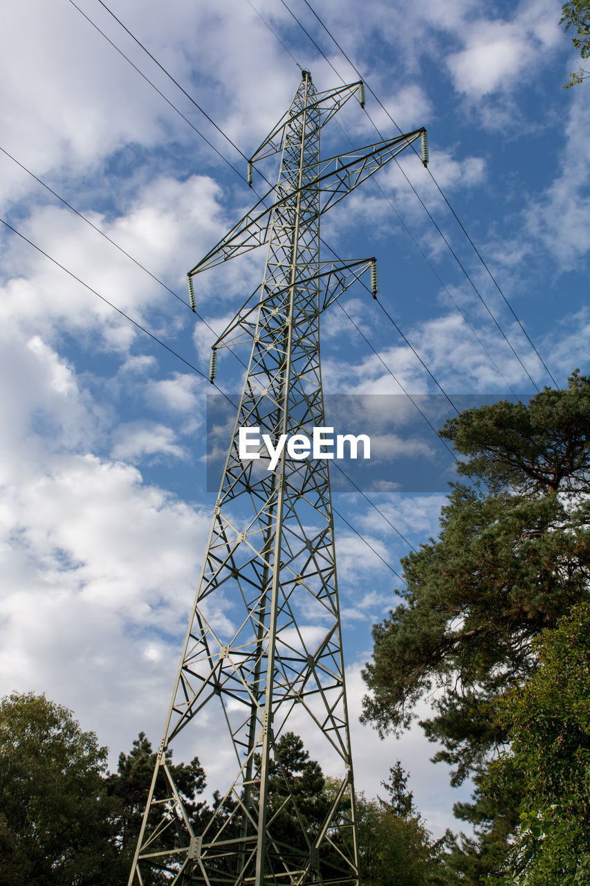 low angle view, sky, cloud - sky, tree, cable, day, electricity, connection, electricity pylon, fuel and power generation, no people, power supply, outdoors, technology, growth, nature