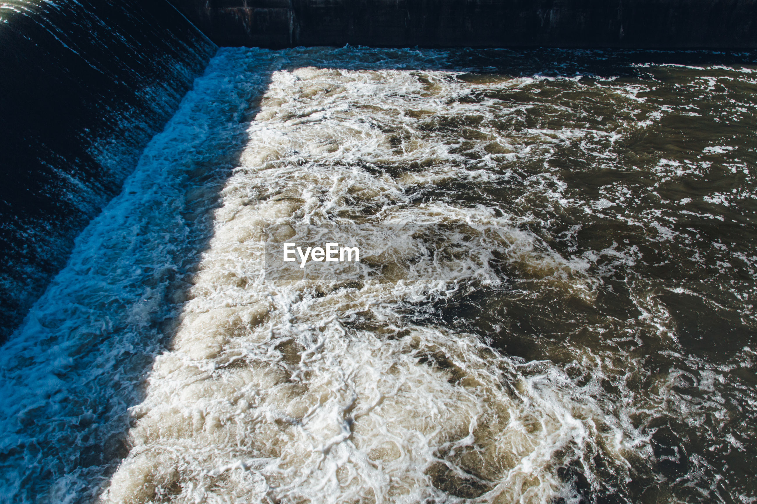High angle view of water flowing in dam