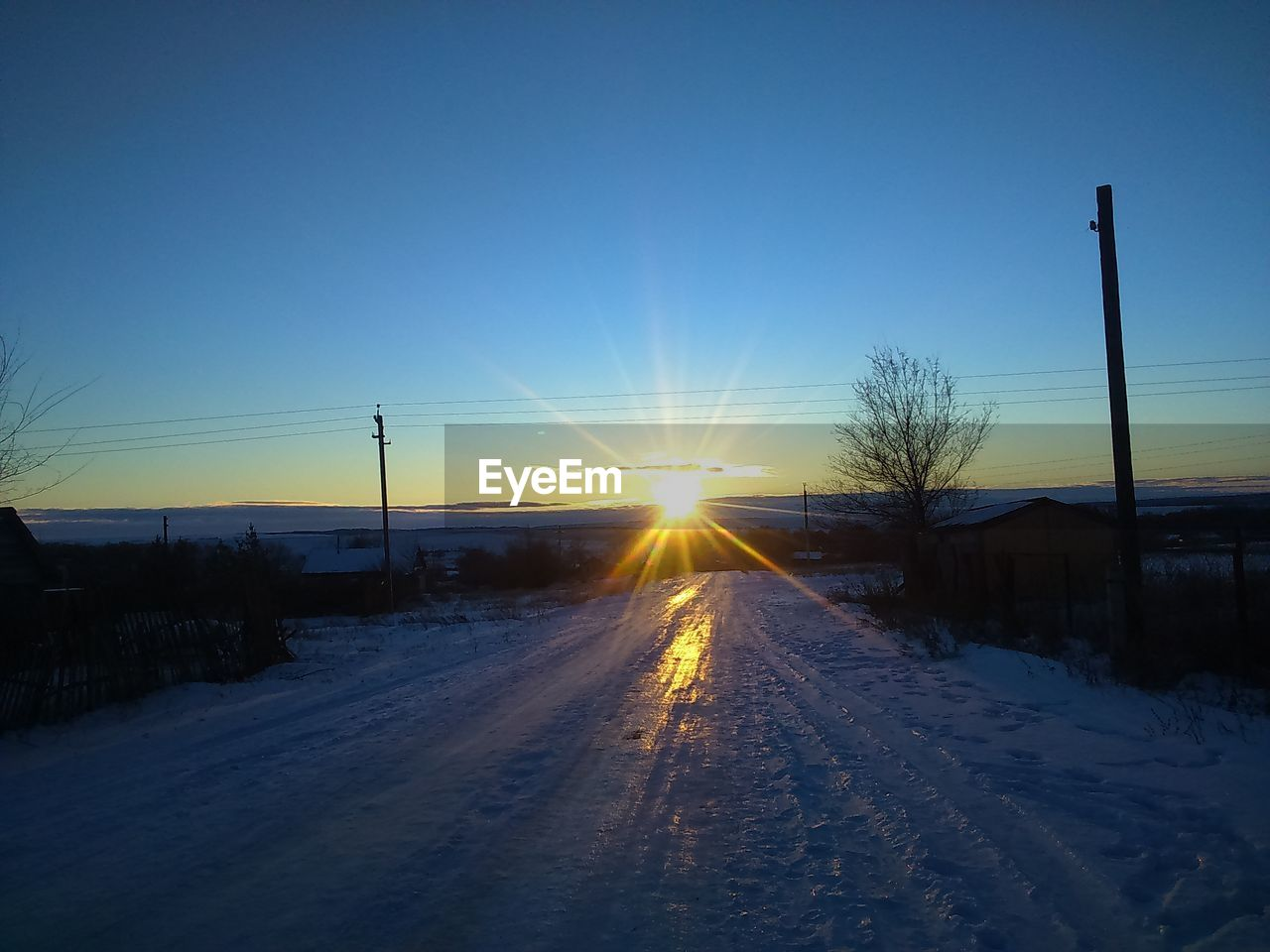 cold temperature, winter, snow, sunset, nature, weather, sun, no people, scenics, beauty in nature, outdoors, frozen, tranquility, bare tree, tranquil scene, sunlight, transportation, clear sky, landscape, sky, tree, day