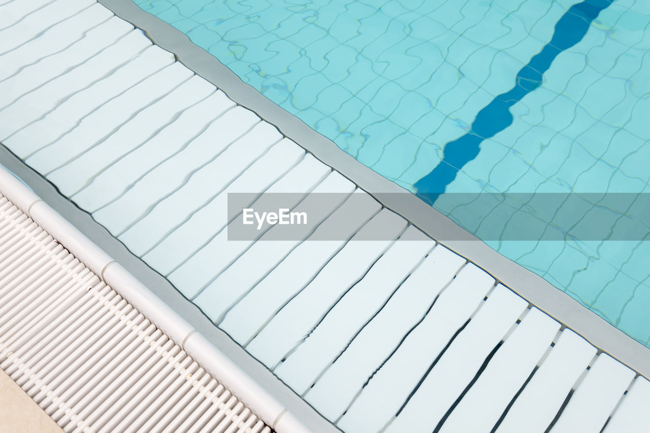 pool, swimming pool, water, pattern, high angle view, no people, nature, day, blue, tile, flooring, sunlight, architecture, full frame, white color, poolside, backgrounds, outdoors, built structure, turquoise colored, tiled floor, luxury