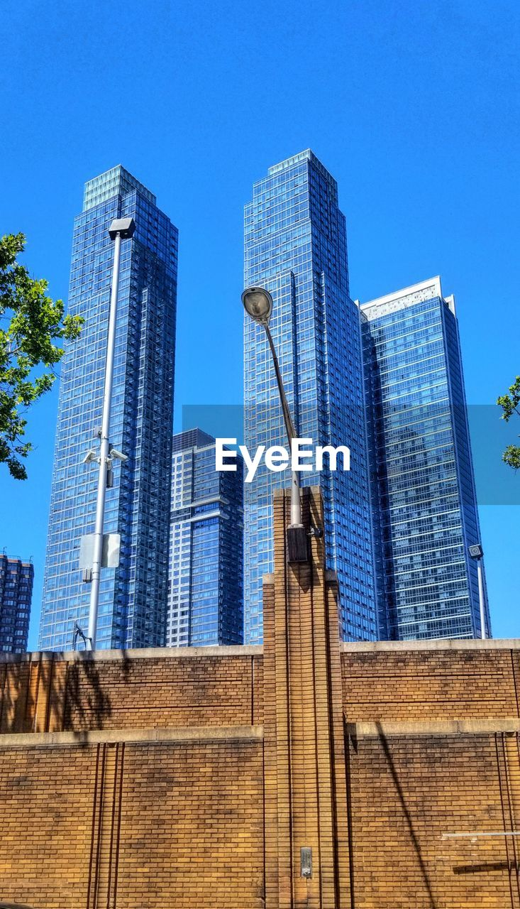 built structure, building exterior, architecture, office building exterior, building, city, sky, skyscraper, low angle view, modern, tall - high, blue, tower, office, no people, nature, clear sky, day, urban skyline, outdoors, financial district, spire