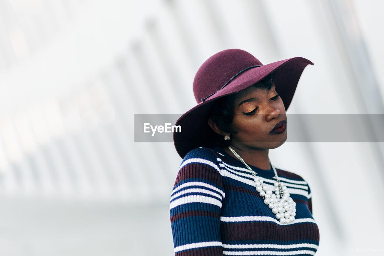 Fashionable woman wearing maroon hat