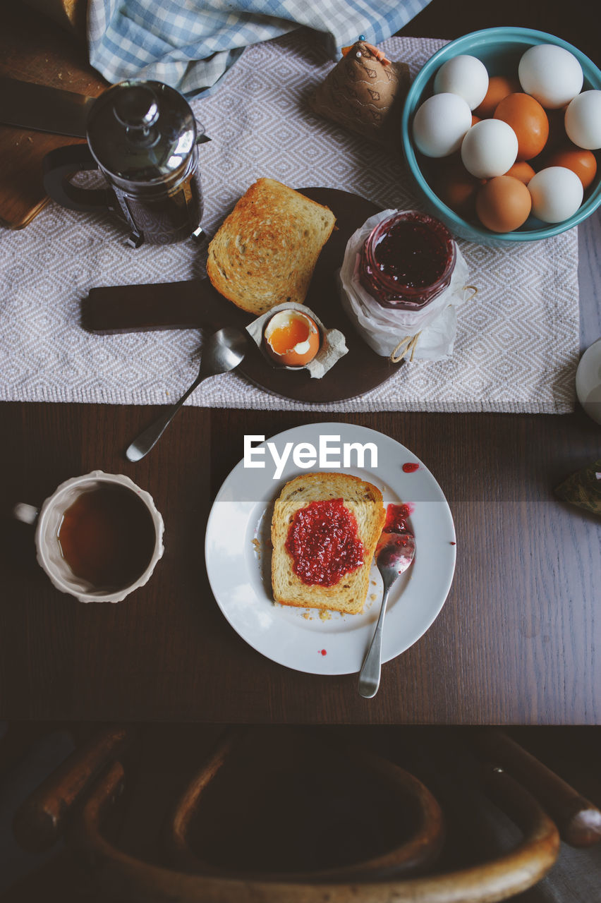 food and drink, food, drink, table, freshness, refreshment, breakfast, meal, coffee, cup, egg, coffee - drink, high angle view, plate, healthy eating, mug, indoors, coffee cup, no people, ready-to-eat, crockery, glass