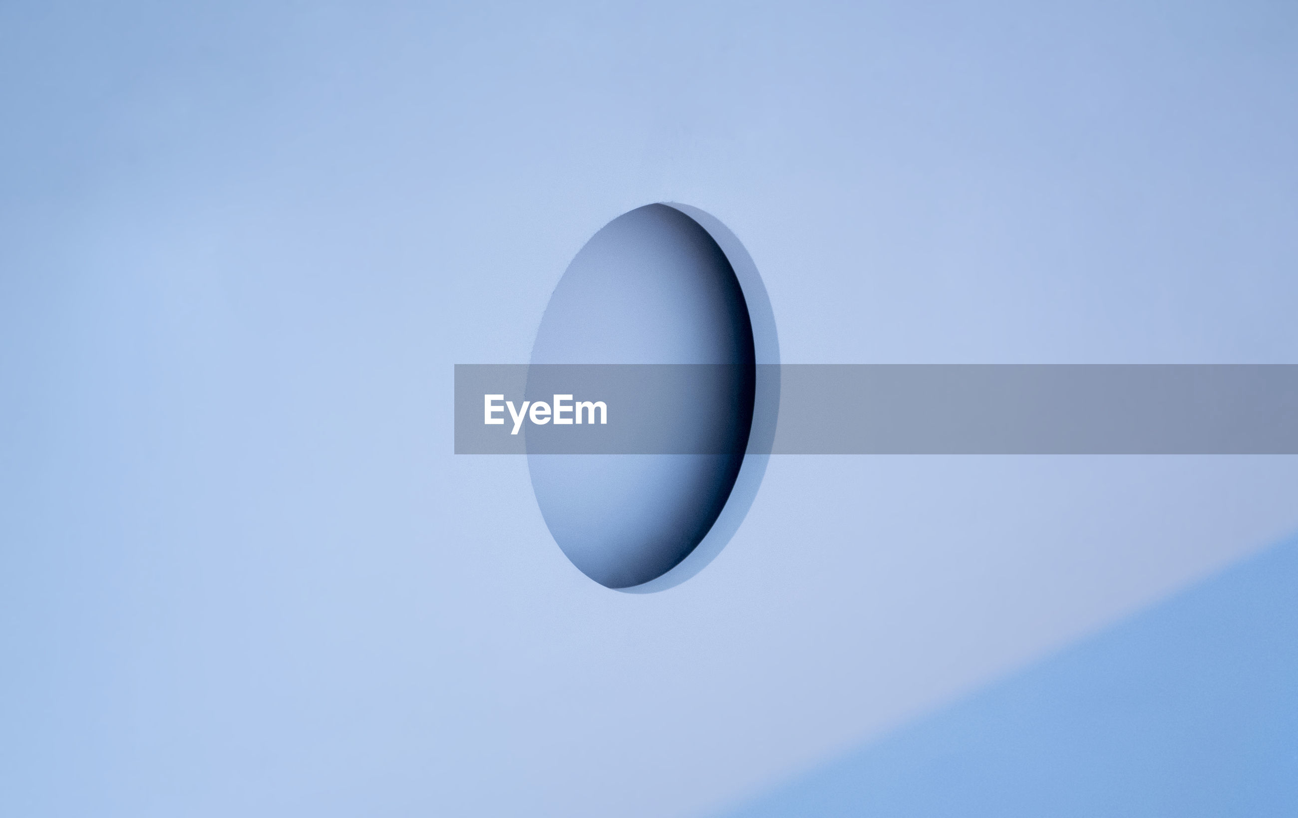 Close-up of circle shape on blue metal