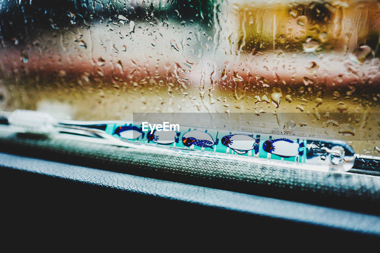 wet, close-up, drop, water, indoors, window, transparent, no people, glass - material, selective focus, nature, blue, rain, still life, focus on foreground, vehicle interior, food and drink, rainy season, raindrop