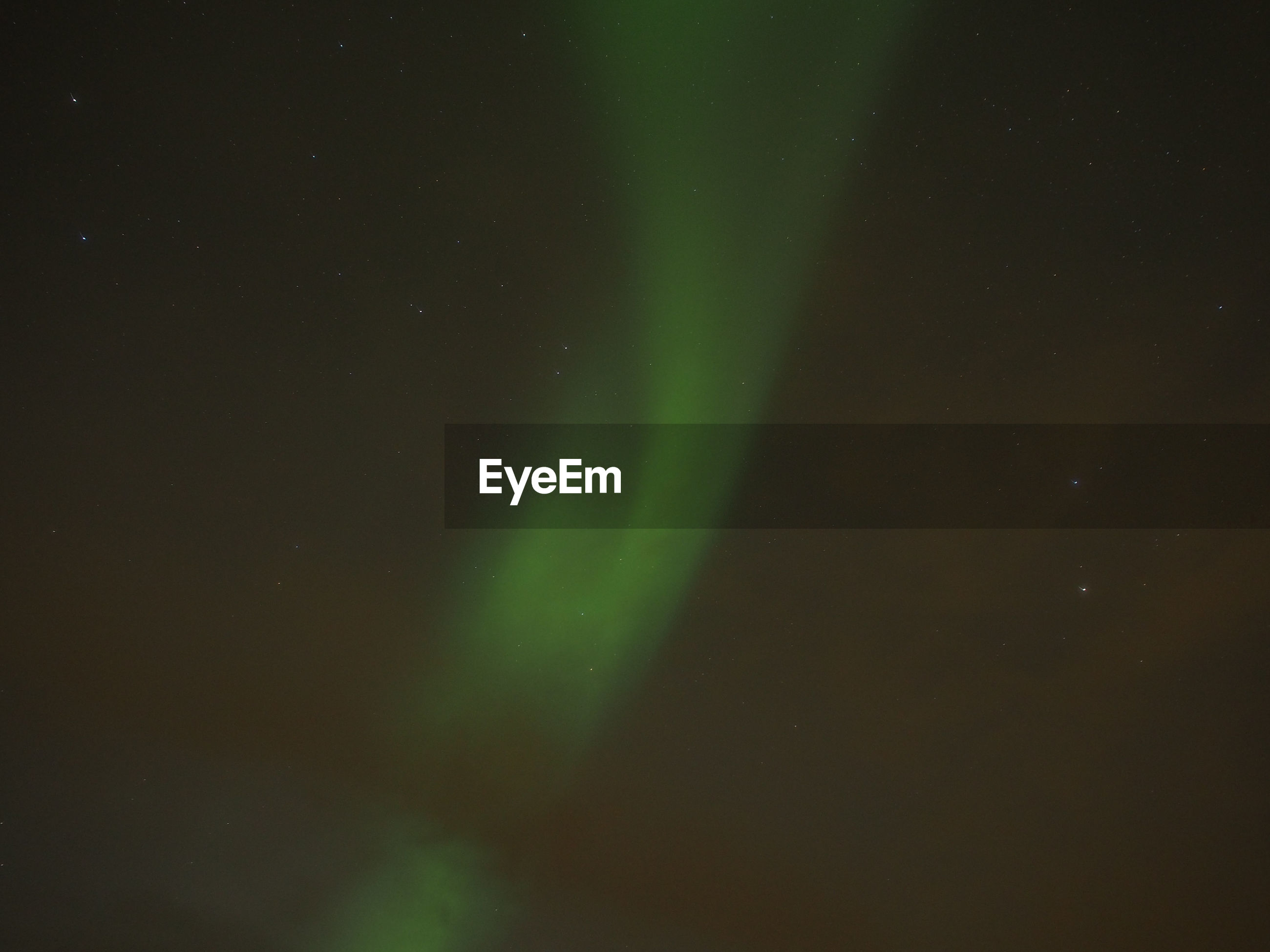 Low angle view of aurora borealis against star field