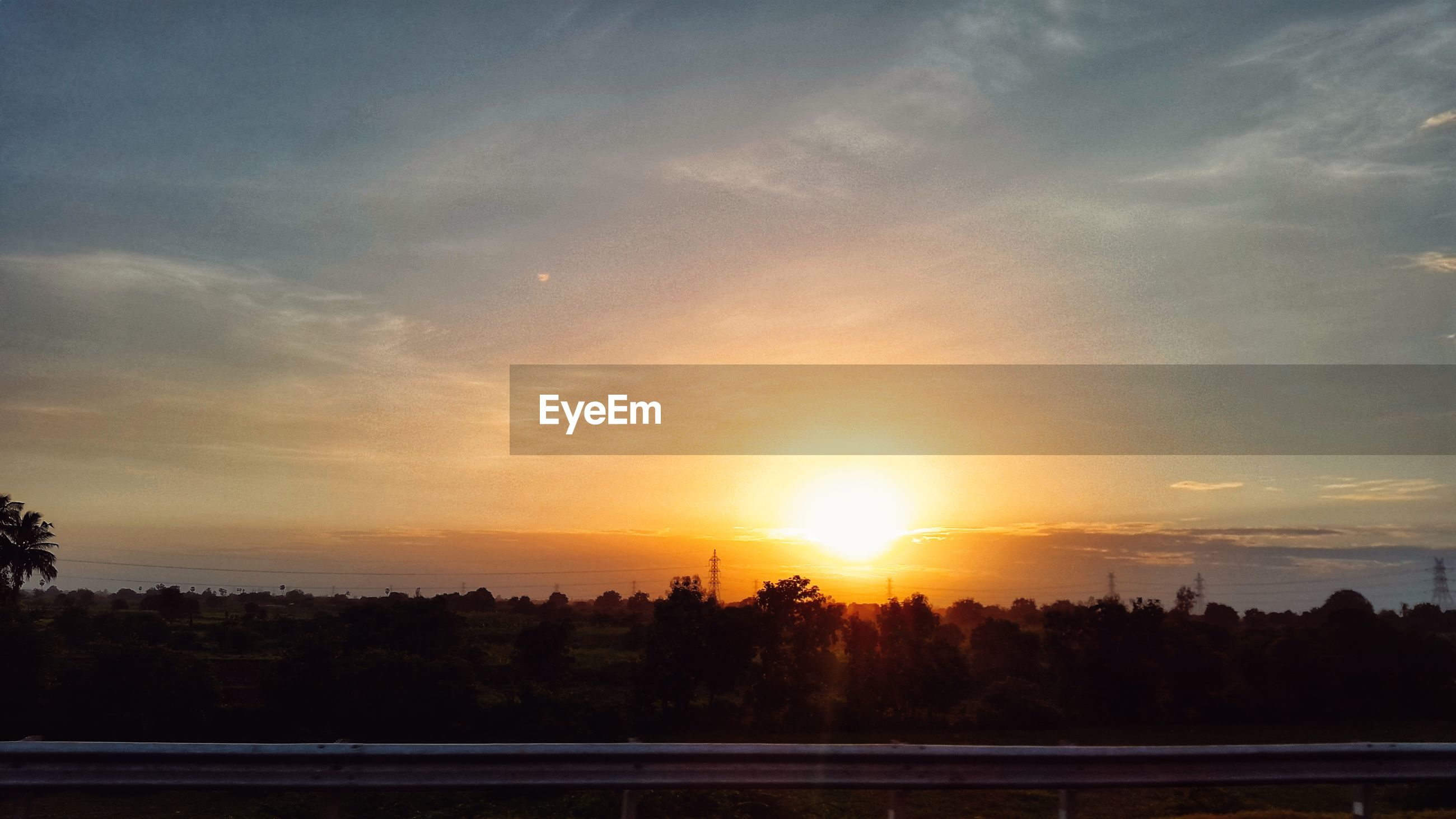 SCENIC VIEW OF SUNSET OVER SILHOUETTE LANDSCAPE