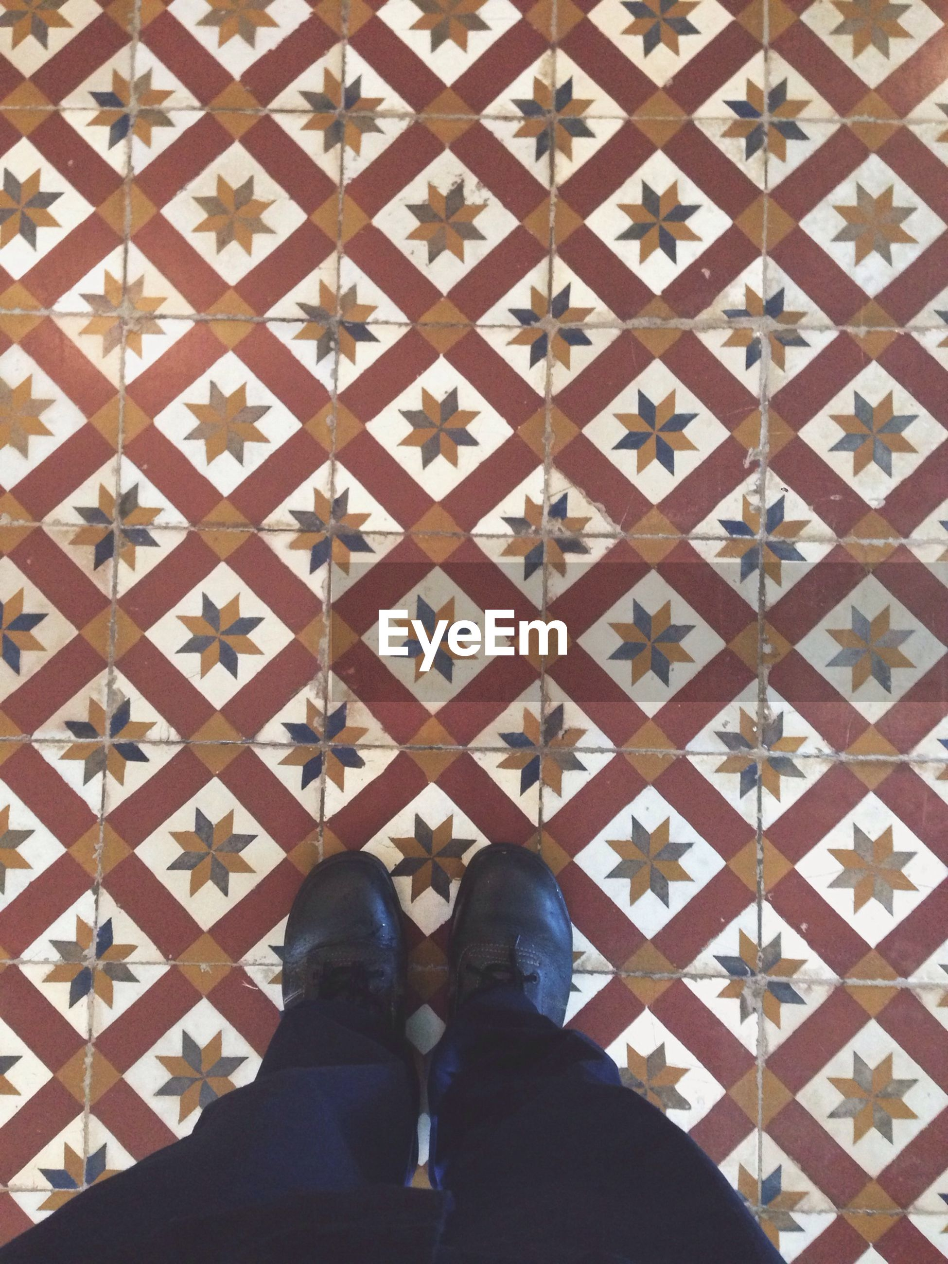 low section, person, indoors, personal perspective, shoe, standing, human foot, pattern, men, lifestyles, flooring, unrecognizable person, built structure, architecture, tiled floor, part of, footwear