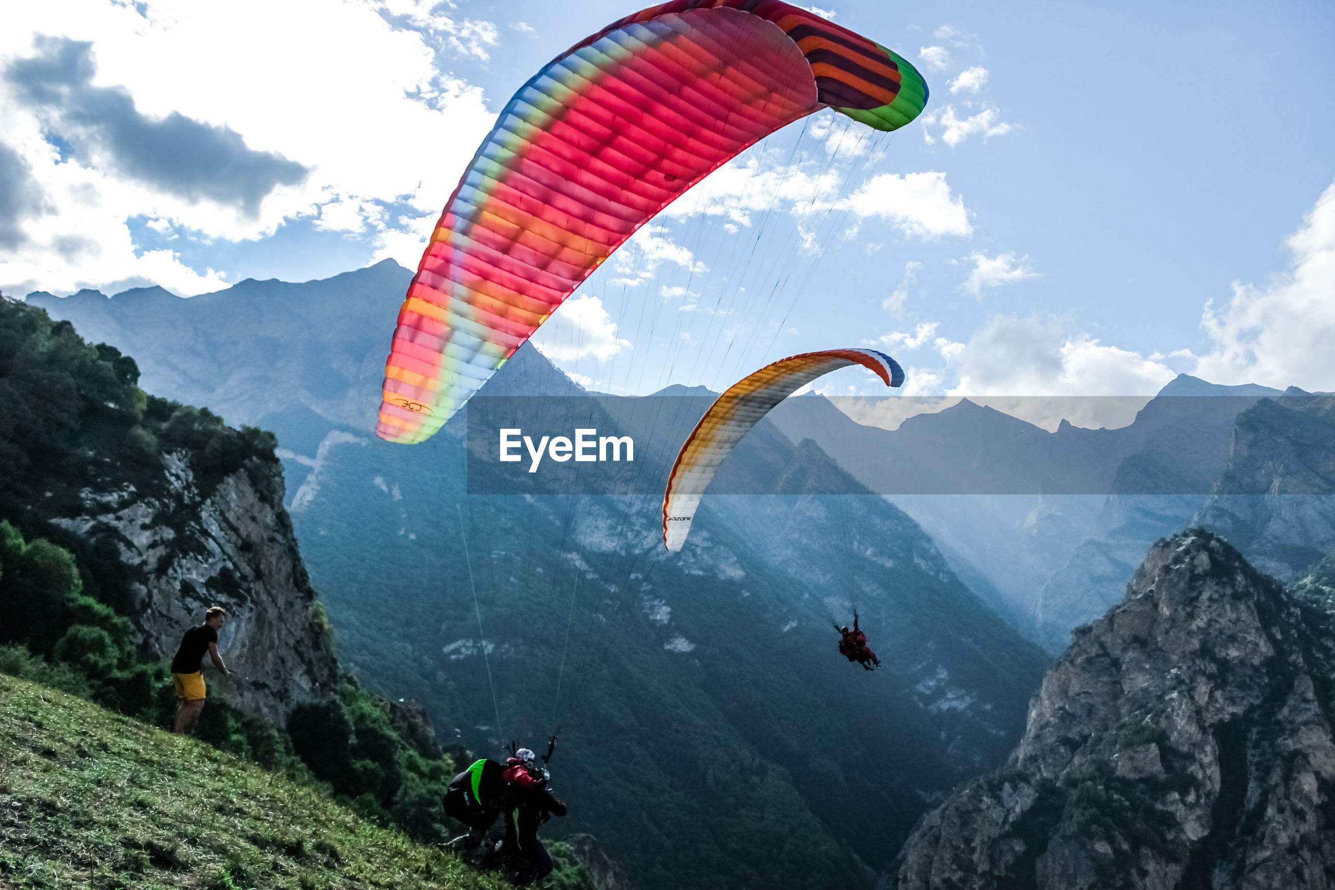 People paragliding over mountains