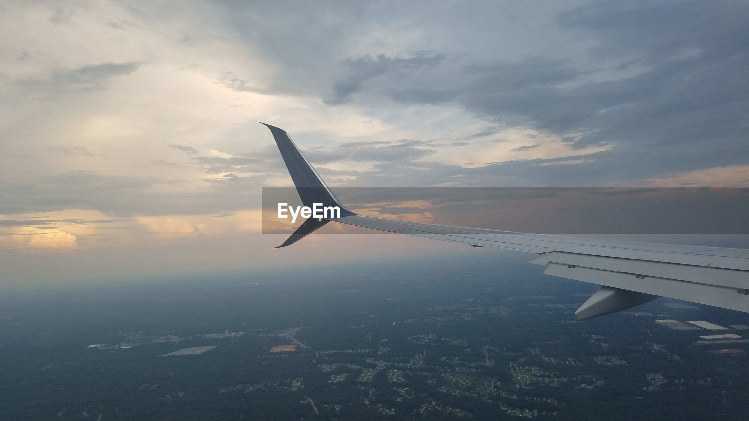 airplane, flying, air vehicle, sky, sunset, journey, transportation, airplane wing, cloud - sky, aerial view, aircraft wing, mid-air, nature, mode of transport, travel, no people, beauty in nature, outdoors, scenics, day