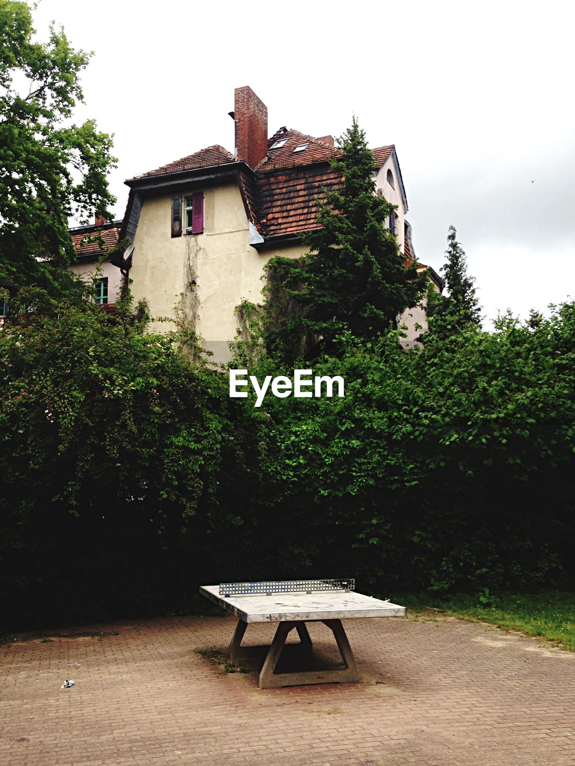 Table in yard in front of houses against sky