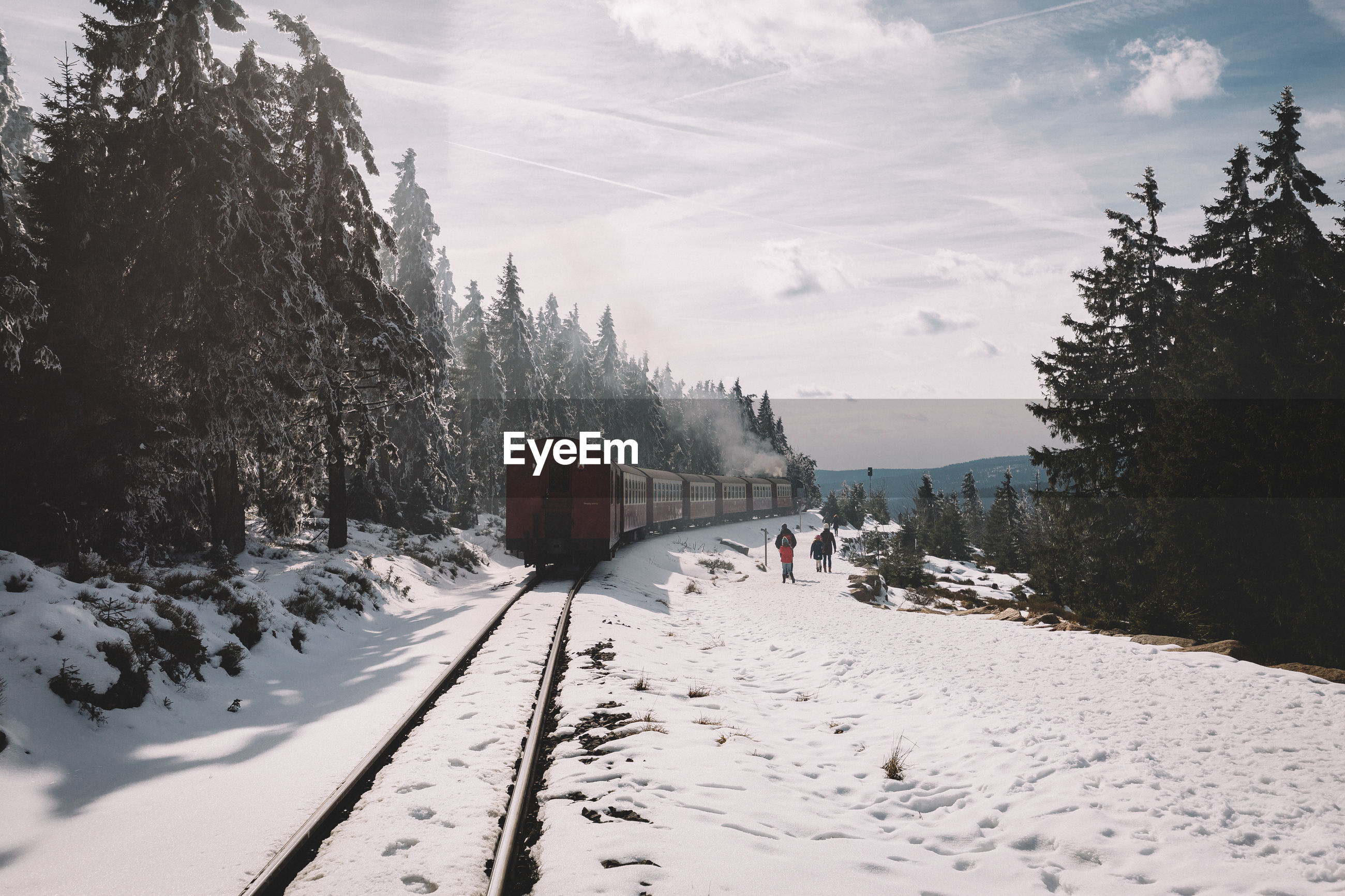 Train on track during winter against sky