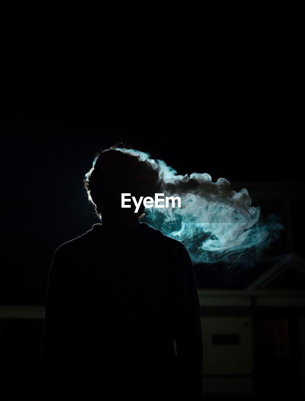 Silhouette Man Smoking At Night