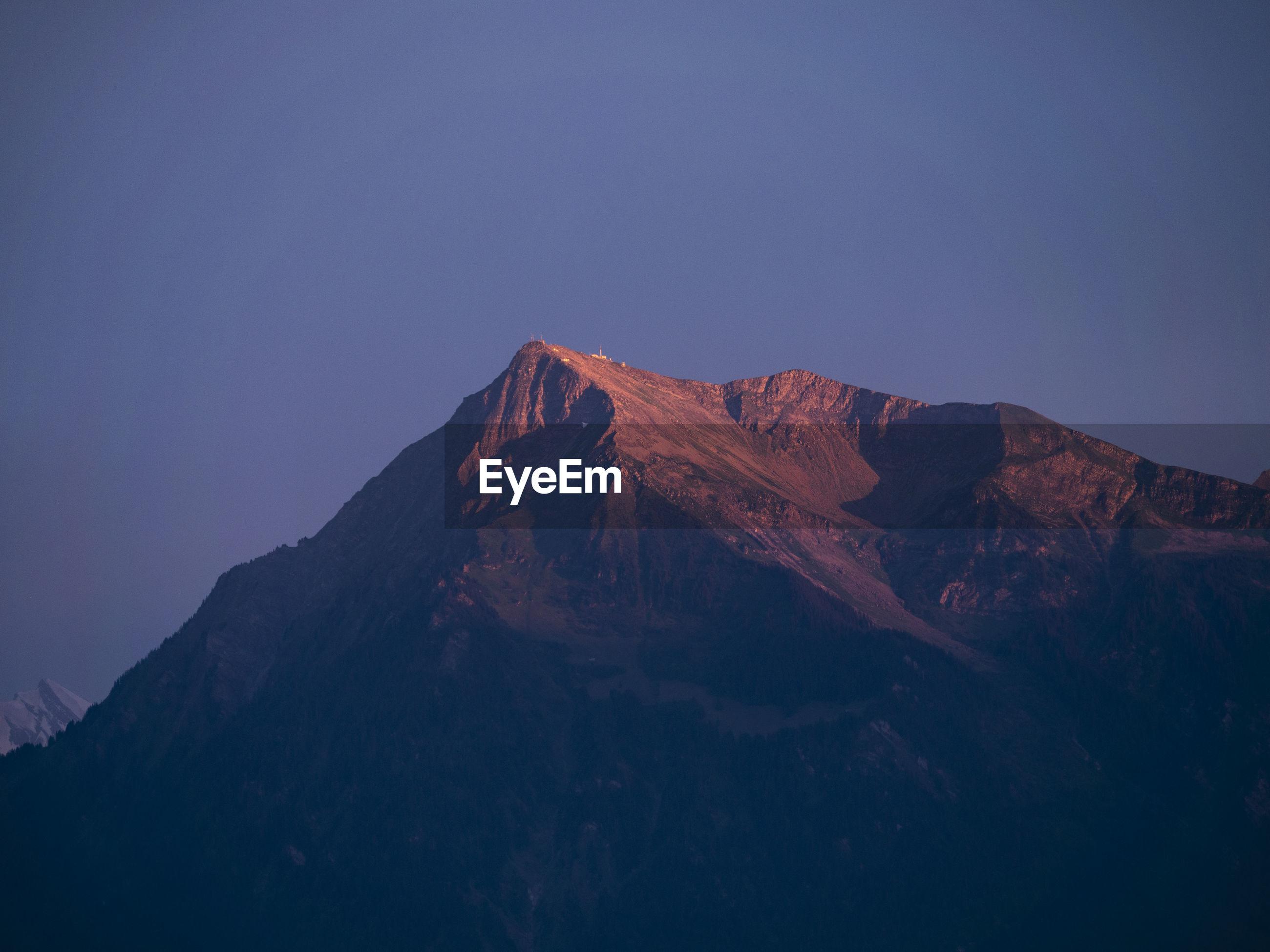 MOUNTAIN RANGE AGAINST BLUE SKY