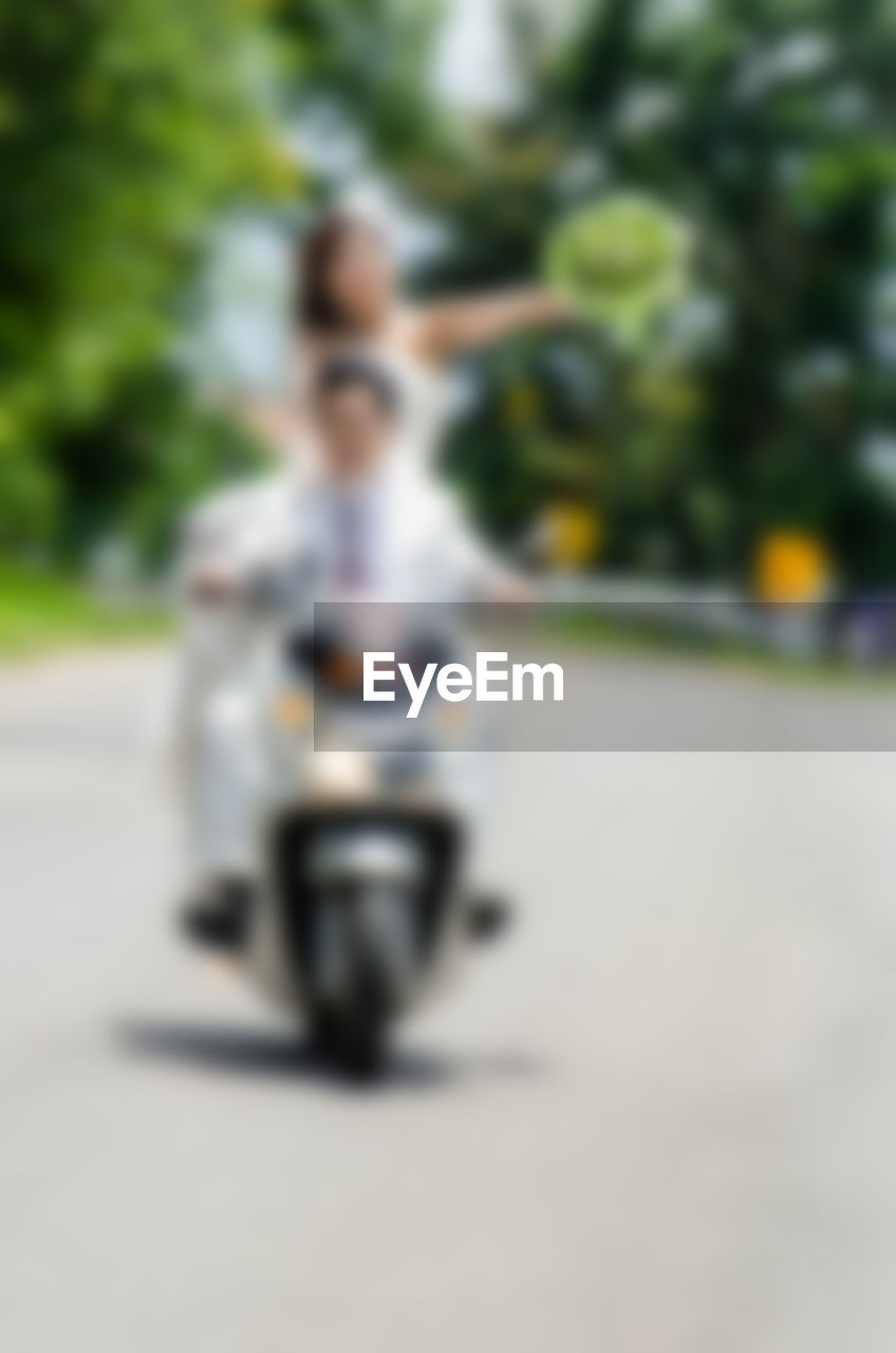 transportation, riding, rear view, road, real people, the way forward, childhood, one person, mode of transport, land vehicle, day, outdoors, lifestyles, full length, sitting, girls, motorcycle, women, mammal, nature, close-up, people