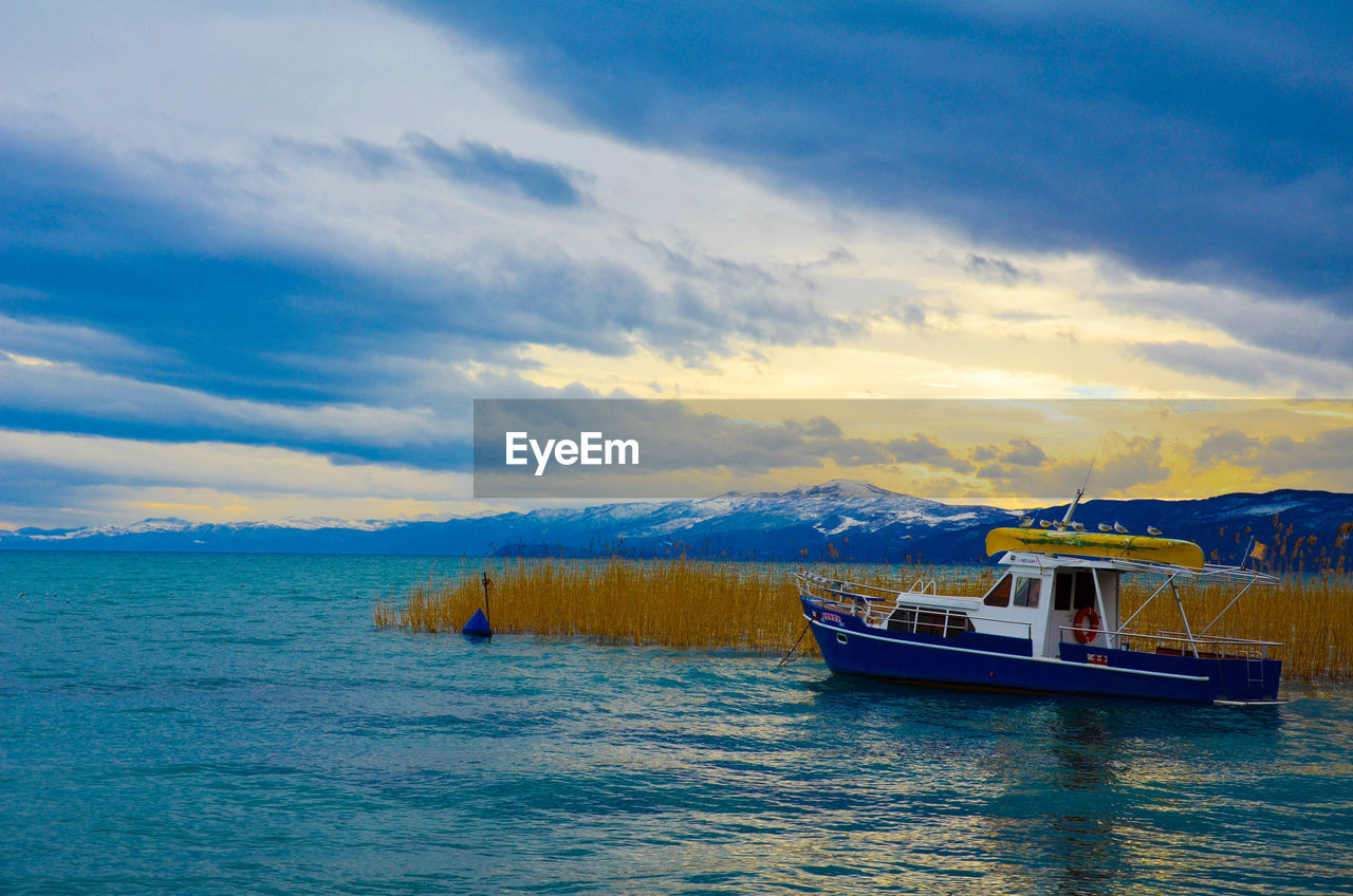 nautical vessel, water, nature, transportation, sky, scenics, boat, mode of transport, sea, beauty in nature, cloud - sky, no people, waterfront, outdoors, tranquility, day